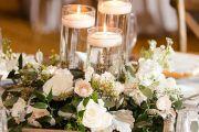 στολισμο γάμου με λευκα λουλουδια και κερια